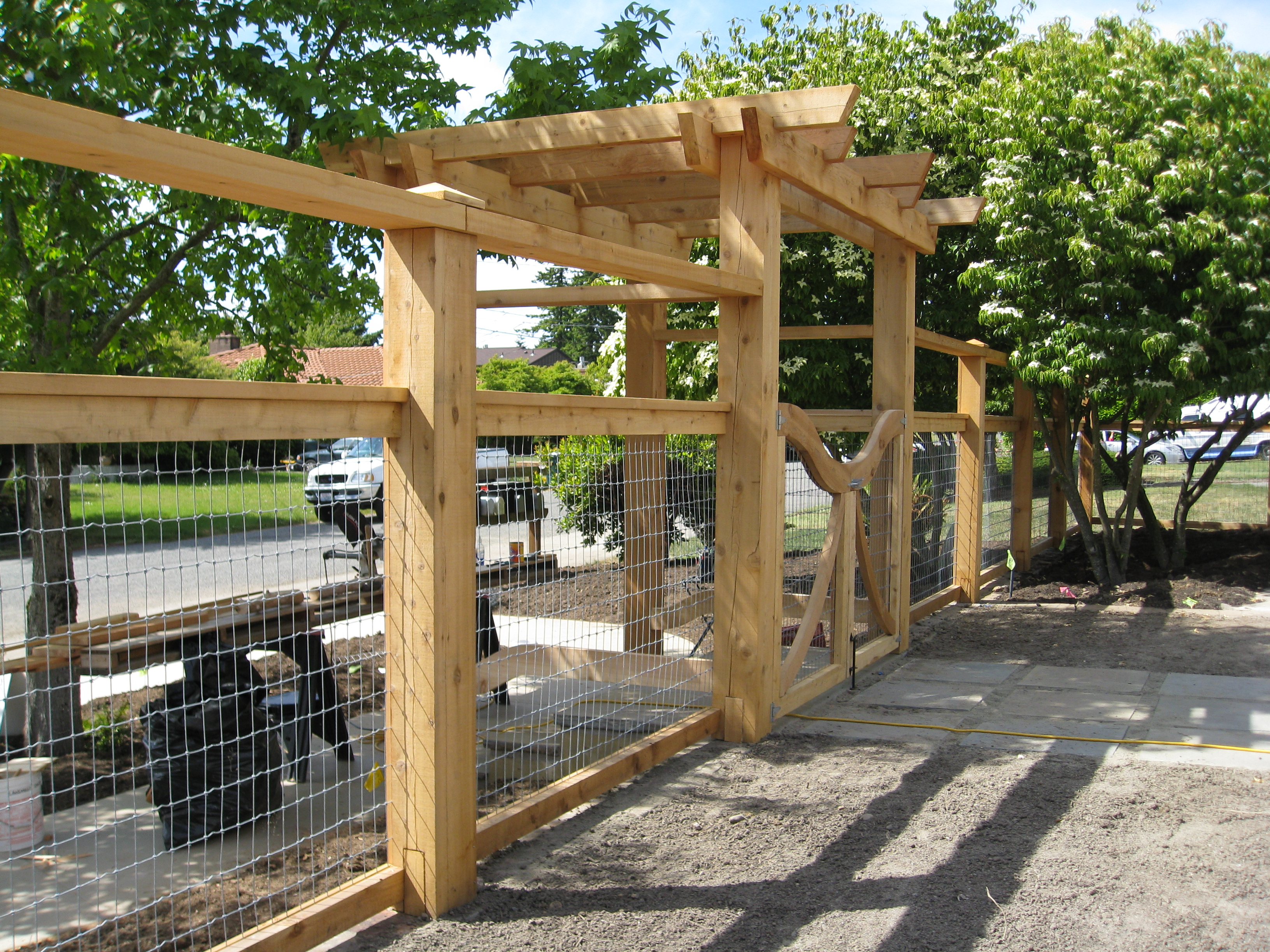timber arbor and wire fence | katemartindesign.com